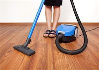 Woman cleaning the floor with vacuum cleaner Stock Photo - Royalty-Freenull, Code: 400-06853348
