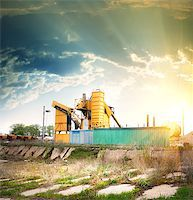 Orange grain elevator on a concrete pedestal Stock Photo - Royalty-Freenull, Code: 400-06858998