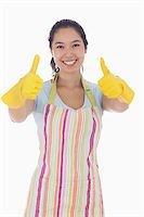 rubber apron woman - Happy woman giving thumbs up in rubber gloves and apron Stock Photo - Royalty-Freenull, Code: 400-06863554