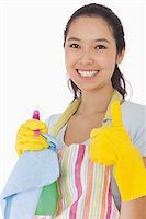 rubber apron woman - Smiling woman with cleaning products giving thumbs up in rubber gloves Stock Photo - Royalty-Freenull, Code: 400-06863628