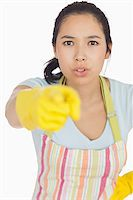 rubber apron woman - Accusing woman in apron and rubber gloves pointing ahead Stock Photo - Royalty-Freenull, Code: 400-06863687