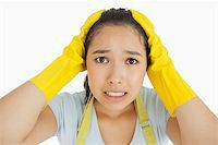 rubber apron woman - Stressed out woman in rubber gloves and apron Stock Photo - Royalty-Freenull, Code: 400-06866413