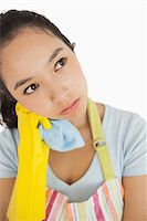 rubber apron woman - Overworked cleaning lady in apron and rubber gloves holding a rag Stock Photo - Royalty-Freenull, Code: 400-06866419