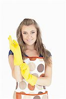 rubber apron woman - Portrait of beautiful young maid with rubber gloves over white background Stock Photo - Royalty-Freenull, Code: 400-06870596