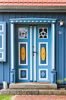 quaint house - Traditional ornate door in Born, Fischland-Darss-Zingst, Coast of the Baltic Sea, Mecklenburg-Western Pomerania, Germany, Europe Stock Photo - Premium Rights-Managednull, Code: 700-06892493
