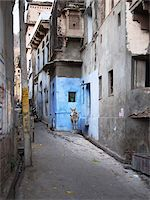 street view with sacred cow in old quarter of Binda, India Stock Photo - Premium Rights-Managednull, Code: 700-06892561