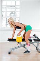 fit people - Woman Lifting yellow Kettlebell on Bench in Fitness Studio, Copenhagen, Denmark Stock Photo - Premium Royalty-Freenull, Code: 600-06895027