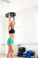 Woman Lifting Weight over her Head in Fitness Studio, Copenhagen, Denmark Stock Photo - Premium Royalty-Freenull, Code: 600-06895030