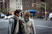 Smiling couple walking together down city street Stock Photo - Premium Royalty-Freenull, Code: 614-06896559