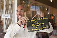 small business owners - Shopkeeper turning open sign on vintage shop door Stock Photo - Premium Royalty-Freenull, Code: 614-06896770