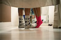 Young couple wearing socks in changing room, low section Stock Photo - Premium Royalty-Freenull, Code: 614-06896782