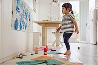 Female toddler inspecting her painting and drawing Stock Photo - Premium Royalty-Freenull, Code: 614-06896952