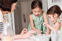 Mother and young daughters making pastry Stock Photo - Premium Royalty-Freenull, Code: 614-06896964