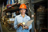 services - Portrait of young woman in warehouse with clipboard Stock Photo - Premium Royalty-Freenull, Code: 614-06897359