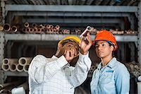 pipe (industry) - Two warehouse workers looking at copper pipe Stock Photo - Premium Royalty-Freenull, Code: 614-06897363
