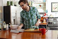Man chopping vegetables Stock Photo - Premium Royalty-Freenull, Code: 614-06897564
