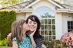 Portrait of daughter kissing mother on cheek in garden Stock Photo - Premium Royalty-Free, Artist: Boone Rodriguez, Code: 614-06897675