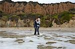 Mature couple standing in sea kissing Stock Photo - Premium Royalty-Free, Artist: Cultura RM, Code: 614-06897721