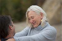 Mature woman smiling with mature man Stock Photo - Premium Royalty-Freenull, Code: 614-06897737