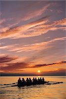 sport rowing teamwork - Eight people rowing at sunset Stock Photo - Premium Royalty-Freenull, Code: 614-06897796