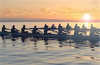 sport rowing teamwork - Twelve people rowing at sunset Stock Photo - Premium Royalty-Freenull, Code: 614-06897798