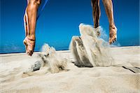 fitness   mature woman - Two beach volleyball players jumping mid air in sand Stock Photo - Premium Royalty-Freenull, Code: 614-06898044