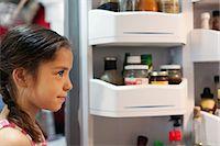 fridge - Girl looking into fridge Stock Photo - Premium Royalty-Freenull, Code: 614-06898164