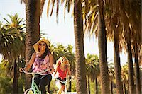 palm - Women on bicycle laughing Stock Photo - Premium Royalty-Freenull, Code: 614-06898326
