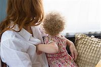 Mother & child looking out window Stock Photo - Premium Royalty-Freenull, Code: 614-06898403