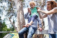 swing (sports) - Parents swinging child by the arms Stock Photo - Premium Royalty-Freenull, Code: 614-06898419