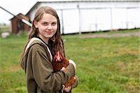 farming (raising livestock) - Girl carrying hen Stock Photo - Premium Royalty-Freenull, Code: 614-06898459