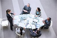 strategy - High angle view of gesturing businesswoman leading meeting Stock Photo - Premium Royalty-Freenull, Code: 6113-06899132
