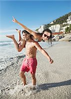 Portrait of happy man lifting woman on beach Stock Photo - Premium Royalty-Freenull, Code: 6113-06899241