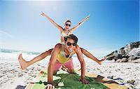 Enthusiastic couple piggybacking on beach Stock Photo - Premium Royalty-Freenull, Code: 6113-06899272
