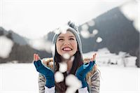people falling - Happy woman enjoying falling snow in field Stock Photo - Premium Royalty-Freenull, Code: 6113-06899335