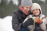 Happy couple drinking coffee in snow Stock Photo - Premium Royalty-Freenull, Code: 6113-06899482