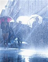 people with umbrellas in the rain - Business people with umbrellas in rain Stock Photo - Premium Royalty-Freenull, Code: 6113-06899532
