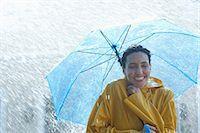 people with umbrellas in the rain - Happy woman under umbrella in rain Stock Photo - Premium Royalty-Freenull, Code: 6113-06899573