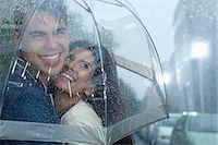 people with umbrellas in the rain - Happy couple hugging under umbrella in rain Stock Photo - Premium Royalty-Freenull, Code: 6113-06899582