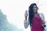people with umbrellas in the rain - Portrait of smiling woman under umbrella in rain Stock Photo - Premium Royalty-Freenull, Code: 6113-06899594