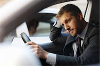 Unhappy businessman stuck in traffic inside car Stock Photo - Premium Royalty-Freenull, Code: 6113-06899681