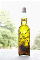 Still life of bottle of olive oil with herbs on window sill, Germany Stock Photo - Premium Royalty-Freenull, Code: 600-06899767