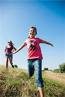 preteen open mouth - Girls running in field, Germany Stock Photo - Premium Royalty-Freenull, Code: 600-06899867