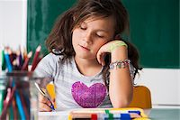 preteen girl pigtails - Girl sitting at desk in classroom, Germany Stock Photo - Premium Royalty-Freenull, Code: 600-06899892