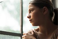 Girl looking out of window, Germany Stock Photo - Premium Royalty-Freenull, Code: 600-06899907