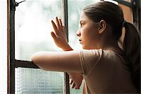 preteen touch - Girl looking out of window, Germany Stock Photo - Premium Royalty-Freenull, Code: 600-06899909