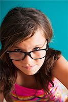 preteen girls faces photo - Portrait of girl wearing eyeglasses, looking at camera, Germany Stock Photo - Premium Royalty-Freenull, Code: 600-06899915