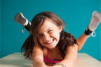 preteen girl pigtails - Portrait of girl looking at camera, making funny faces, Germany Stock Photo - Premium Royalty-Freenull, Code: 600-06899921
