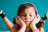 preteen girls faces photo - Close-up portrait of girl wearing headphones with eyes closed, Germany Stock Photo - Premium Royalty-Freenull, Code: 600-06899923