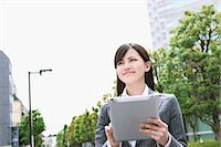 Businesswoman with tablet Stock Photo - Premium Royalty-Freenull, Code: 622-06900447